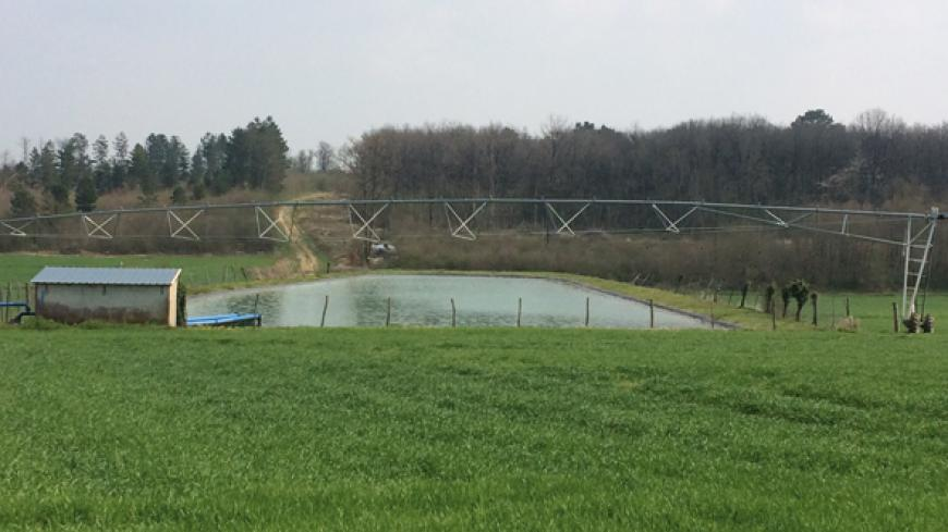 The problem facing Mr. Reinier is how to irrigate a sloping field with a 4-metres high water catchment dam in the middle.